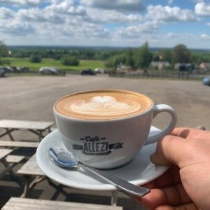Cafe Allez! Belvoir Castle latte and view